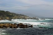 stock photo of pch  - Rocky beach and crashing waves at Pebble Beach - JPG