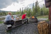 Постер, плакат: Couple Having A Picnic And A Grill