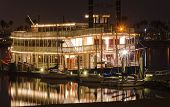 image of memphis tennessee  - Night view of an authentic vintage American riverboat with two chimneys resembling the steamboats used in the 1800s in Mississippi river - JPG
