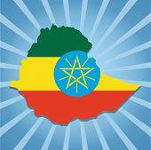 stock photo of ethiopia  - Ethiopia map flag on blue sunburst illustration - JPG