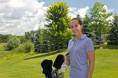 foto of ladies golf  - Golfing woman with her golf bag on the course - JPG
