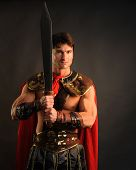 stock photo of biblical  - a sexy hot gladiator with a sword - JPG
