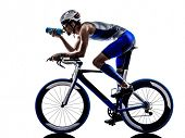 picture of triathlon  - man triathlon iron man athlete biker cyclist bicycling biking drinking in silhouette on white background - JPG