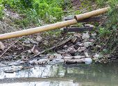 foto of sewage  - PVC pipeline over the sewage canal in urban city - JPG