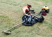 pic of trimmers  - Old weed trimmer on the lawn of park - JPG