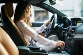 foto of driving  - Young woman driving her car - JPG