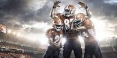 picture of football helmet  - American football players in action on the stadium - JPG