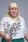 stock photo of disgusting  - portrait of disgusting Russian woman with thistle - JPG