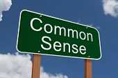 picture of common  - Common Sense Sign Green highway sign with words Common Sense with sky background - JPG