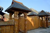 picture of gate  - Such carved wood gate is traditional for Maramuresh region  - JPG