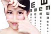 foto of  eyes  - beautiful woman eye close up with the background of eye test chart eye care concept asian beauty - JPG