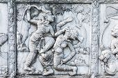 foto of masterpiece  - masterpiece of traditional Thai style stucco art old about Ramayana story on temple decorative wall at Wat Panan Choeng temple Ayutthaya Thailand - JPG