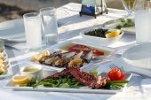 stock photo of ouzo  - seafoods on the dinner table at the beach - JPG