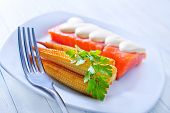 picture of mange-toute  - salmon and corn on white plate and wooden board - JPG
