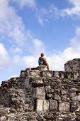 Woman Sitting On Mexican Ruins