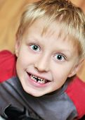 stock photo of tooth-fairy  - little boy showing that he lost first milk tooth - JPG