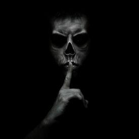 picture of evil  - Evil Man Gesturing Silence - JPG