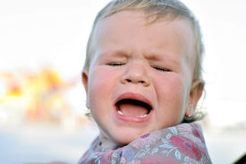 stock photo of fussy  - portrait of crying baby girl with sad face - JPG