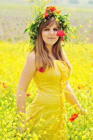 picture of grils  - gril wearing yellow dress with wreath in field - JPG