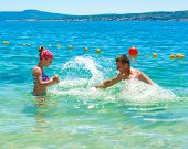 picture of father time  - Happy father and daughter enjoying summer time in the sea - JPG