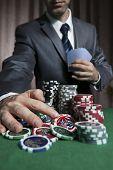 stock photo of won  - Blackjack WinnerA Businessman Won In Blackjack Game And Take All The Chips  - JPG