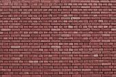 stock photo of marsala  - detail of a marsala brick wall background - JPG