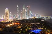 stock photo of dubai  - Dubai Marina skyscrapers at night. Dubai United Arab Emirates ** Note: Visible grain at 100%, best at smaller sizes - JPG