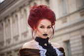 picture of gothic  - sexy woman with gothic makeup and red hair and castle - JPG