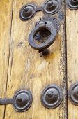 stock photo of hasp  - Forefront of the handle of a wooden door - JPG