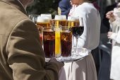foto of catering  - Professional catering service serving drinks to guests - JPG