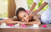 pic of therapist massage  - Smiling woman enjoying a massage - JPG
