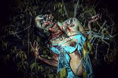 pic of bloody  - Horrible bloody zombie girl standing outdoor - JPG