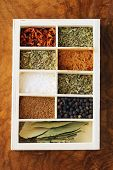 image of bay leaf  - set of different spices (pepper, salt, turmeric, bay leaves, chili, herbs) in a wooden box - JPG