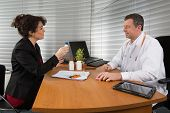 image of prophylactic  - Businessman with Female Doctor at her office - JPG