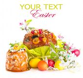stock photo of pasqua  - Easter Cake and colorful painted Eggs - JPG