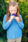 stock photo of pullovers  - Outdoor portrait of a cute little girl of 7 years old - JPG