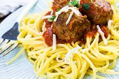 foto of cilantro  - Homemade Italian meatballs garnished with cilantro and parmesan cheese over spaghetti for dinner - JPG