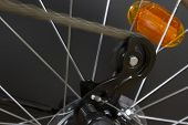 picture of bicycle gear  - wallpaper of bicycle close up on wheel and moving chain on gear - JPG