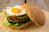 image of burger  - Shot of burger with fried egg horizontal - JPG