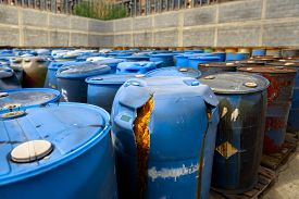 picture of toxic substance  - Several barrels of toxic waste at the dump  - JPG