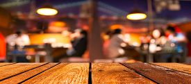 picture of wooden table  - empty brown wooden table and Coffee shop blur background with bokeh image - JPG