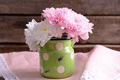 stock photo of chrysanthemum  - Beautiful chrysanthemums in pitcher on wooden background - JPG