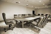 large table and chairs in a modern conference room