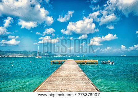 Pier In Turquoise Sea And