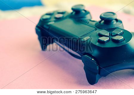 poster of A Beautiful Black Modern Digital Game Joystick To Control A Video Game Console For Video Games With