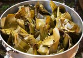 Steamed Food / Dessert Wrapped With Banana Leaf In Sticky Rice And Banana poster