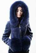Fashion Concept. Girl Elegant Lady Wear Fashionable Coat Jacket With Furry Hood. Luxurious Fur. Girl poster