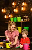 Save Earth Concept. Mother And Son Transplanting Flower In New Pot To Save Earth. Mother And Child T poster