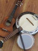 Close-up Of Three Brazilian Musical Instruments: Cavaquinho, Samba Banjo And Tamborim With Drumstick poster