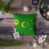 Happy New Year Tag With Cocos Island Flag On Pillow. Christmas Decoration Concept On Wooden Table Wi poster